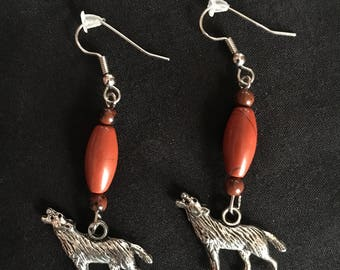 Native American earrings with wolf charm.