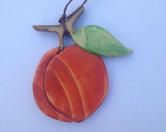 Handmade wooden ornament made from a recycled Christmas tree peach