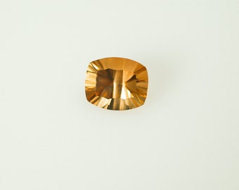 Imperial Topaz, Concave Cut Oval Cushion 6.25 c, 10 X 12 mm