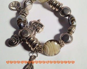 Charm Bracelet. Silver bracelet. Vintage Bangle. Stretch Bangle.  Afrocentric Bangle. Afrocentric Accessories. Bohemian style.