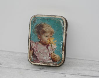 Vintage Tin featuring a girl holding a daffodil