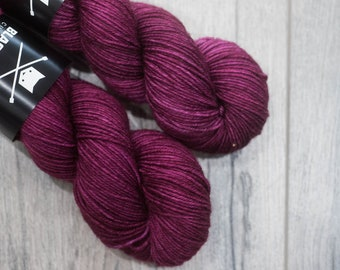 DK weight merino yarn 100% Superwash Merino Sweater weight yarn. Double Knit Weight yarn. Grimace. Semi-Solid purple yarn. Tonal yarn