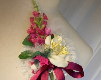 Pink Flower Brooch/Buttonhole with satin flower, net and leaves on a net and lace base.
