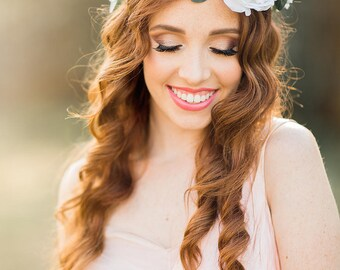 The Layla bridal crown, with white blooms and delicate greenery, boho bridal crown