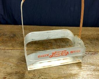 Antique Pepsi bottle holder. Bigger Better. Metal carton.