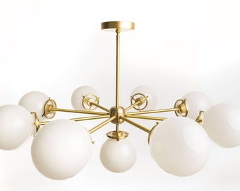 Mid-Century inspired Apollo Chandelier w/Opal glass globes.