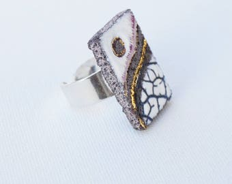 Organic white unstructured rectangular glazed lava ring and touches of gold