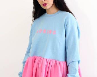 Broken Dreams Ruffle Sweater