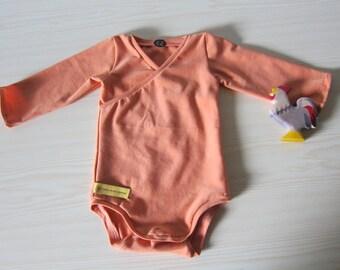 Baby Body in Terracotta orange, organic Jersey size: 3-6 Mo.