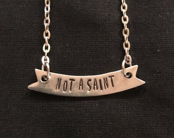NOT A SAINT Quirky Snarky Hand Stamped Banner Necklace - Expression, Expressive, Pewter