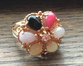 Ornate 14kt gold flower ring with many shades of jade