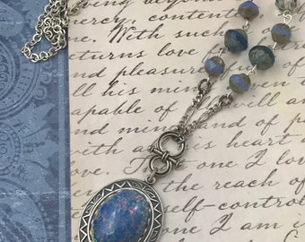 Blue opal glass Oval focal with Swarovski crystals in antique silver 33 inch long chain with 2 1/4inch drop