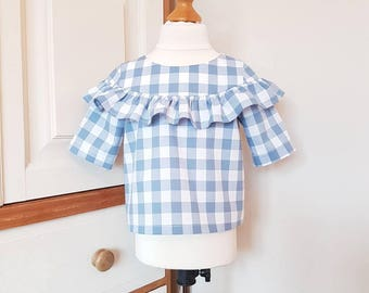Elbow length sleeve ruffle blouse made in blue and white cotton gingham in age 2 to 6 years