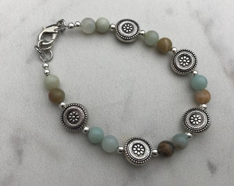 Single strand bracelet with round silver accents
