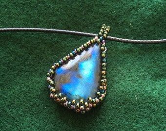 Labradorite necklace in a beautiful beaded cabochon of seed beads on a leather cord