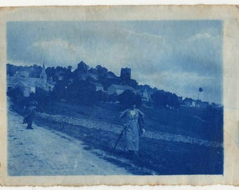 vintage photo cyanotype landscape with 2 characters 1900