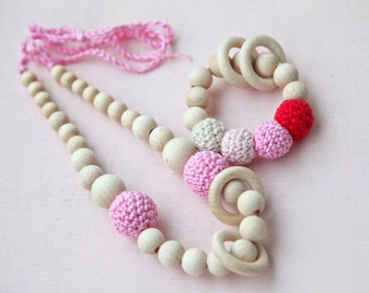 Set of 2. Pink nursing rings necklace and pink, red and beige teething ring toy.
