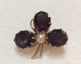 Vintage amethyst colored glass cabochon three leaf clover brooch pin .
