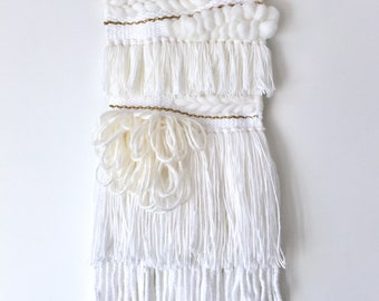 White and Gold woven wall hanging on copper