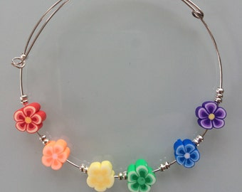 Silver plated bangle with polymer clay flowers