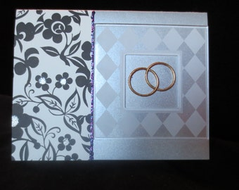 Special anniversary card with gold rings.