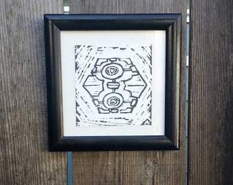 Companion Cube Black and White Linocut Print in Black Frame