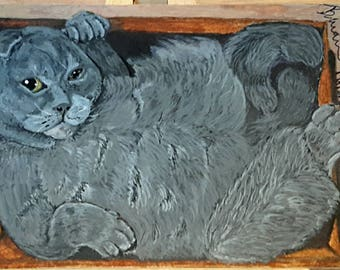 Fat cat in box painting