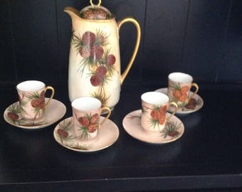 Antique German Chocolate Pot and Four Cups and Saucers in Pinecone Design