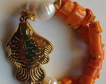 Gems from the sea...bracelet of orange coral, freshwater pearls and gold