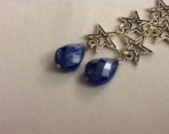 """Dazzling 4"""" star earrings with sparkling, faceted blue stones"""