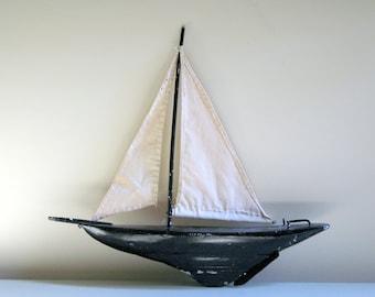 vintage sailboat pond yacht painted black cloth sail coastal decor