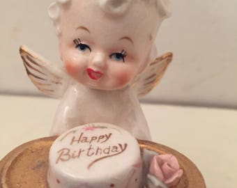 Rare Mid century kitschy angel girl porcelain figurine with happy birthday cake under dome