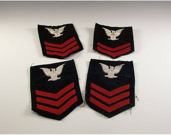 Three Vintage US Navy First Class and One Second Class Chevrons Black Background Red Stripes