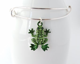 Green frog accented with rhinestones on a silver plated bangle bracelet