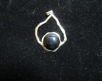 unusual design on this pendant very nice marked 925