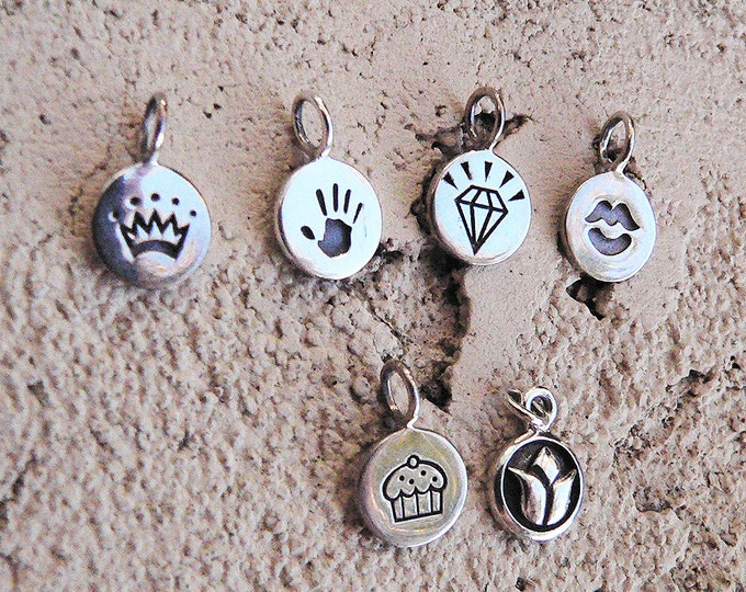 Add a sterling silver charm to your order
