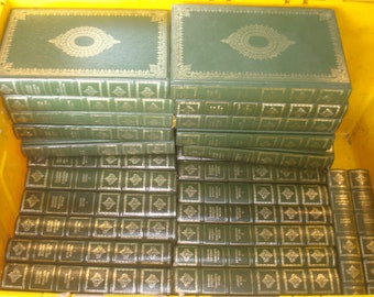 Set of 34 Charles Dickens Vinyl covered books by Heron Books.