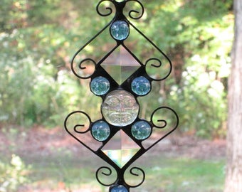 Stained Glass Suncatcher - Clear Iridescent Moonface, Blue Glass Nuggets, Clear Bevels, and Curly Cue Wire
