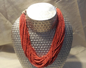 this is a vintage red naga necklace from 1970s