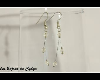 Earrings on twisted wire and the bicone bead transparent /ivoire