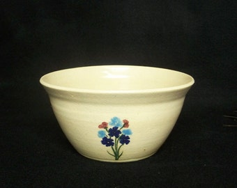 Soup or cereal bowl, stoneware pottery in a creamy white glaze with bouquet of blue, turquoise and red flowers, 3.5x6.75 inches