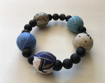 Blue fabric and obsidian beaded bracelet