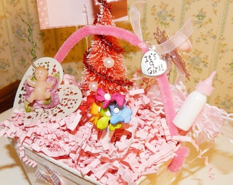 Altered Art Berry Basket ,'' It's a Girl'' Theme with plastic baby doll,plastic bottle brush tree and bottle