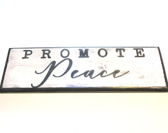 Promote Peace.  Ready to ship wooden sign.  Black and white rustic distressed wooden sign.  Peace.  Ready to ship.