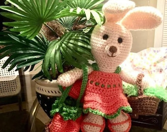 Busy bunny with all the accessories - dress, shoes, carrot purse, and a basket full of carrots!