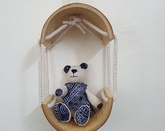 bear in hanging bamboo house
