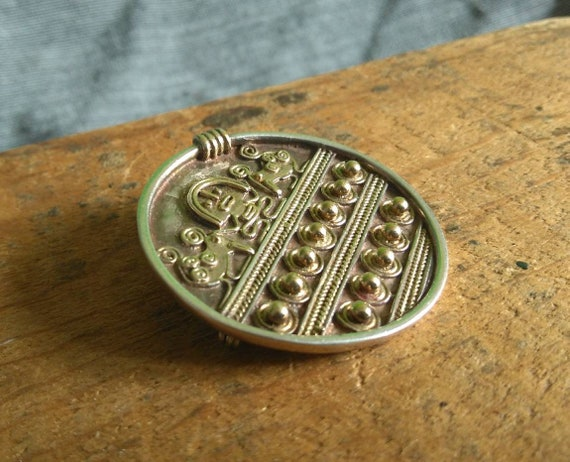 Cool vintage sterling silver signed Woods ethnic, Peruvian, fertility brooch 1970s