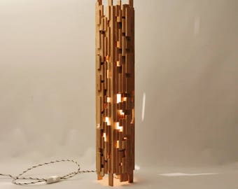 Chaoss Design lamp in recycled oak wood.