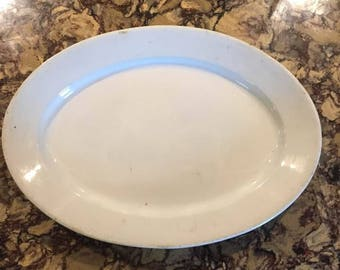 Large, vintage ironstone platter by Baker and Co.