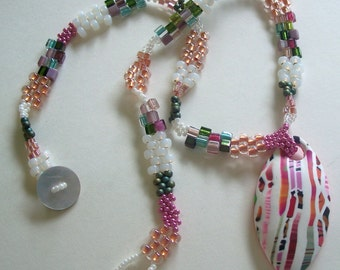 Pink and White Polymer Clay Stroppel Cane Pendant and Bead Woven Necklace by Carol Wilson of PollyClayDesigns